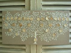 family tree painted on stretched linen with tea-dyed shipping tags to write the names on. so lovely!