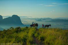 Horse riders watching sunset from Los Aquaticos, Vinales, Cuba