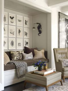Collages by Leigh Wells and a sconce by Blackman Cruz hang above a custom banquette in the living room.   - ELLEDecor.com