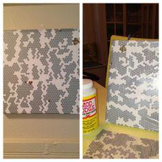 printed tissue paper + modge podge + canvas = cheap DIY art