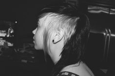 Like this style but not do it blonde.. maybe a deep jewel wine red for the long hair and black for the shaved side