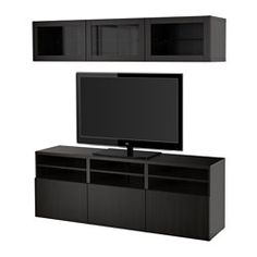 IKEA - BESTÅ, TV storage combination/glass doors, black-brown/Selsviken high gloss/brown smoked glass, drawer runner, push-open, , The drawers and doors have integrated push-openers, so you don't need handles or knobs and can open them with just a light push.This TV storage combination has plenty of extra storage and makes it easy to keep your living room organized.The space-saving wall cabinets make the most of the wall area above your TV.It's easy to keep the cords from your TV and other…