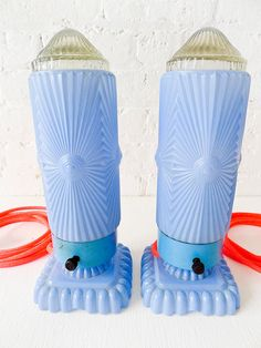 Antique Pair of Baby Blue Art Deco Bullet Lamps w/ Neon Pink Orange Color Cord.  Learn about your collectibles, antiques, valuables, and vintage items from licensed appraisers, auctioneers, and experts.  http://www.bluevaultsecure.com/roadshow-events.php