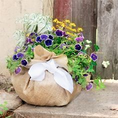 Use burlap and a hanging basket liner to make your own planter - if you can tie a knot you can make it.