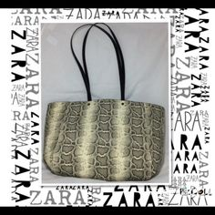 """NWOT Zara Basic Snakeskin Look Large Tote Bag NWOT Zara Basic Snakeskin Look Large Tote Bag  Off white and back faux leather long black shoulder straps , back wall zip compartment , two open compartments. Surprisingly lightweight with secure snap top New without tags. Brand: Zara Basic Bag Depth:6"""" on the bottom  Style: Shoulder Tote Bag Bag Length:19"""" Strap Drop:14"""" Color: off white black Size: Large Bag Height:12"""" Zara Bags Totes"""
