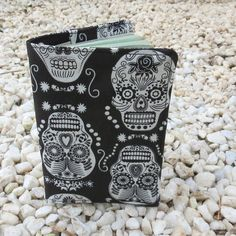 This is a handmade fabric passport cover. It measures x x This cover is made to fit a European Union, US or UK passport. The fabric used is a medium weight cotton, with a black and white skulls design. Passport Cover, Skull Design, Patches, Black And White, Halloween, Dark, Fabric, Handmade, Travel