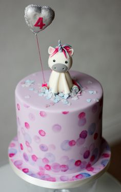 Unicorn birthday cake, unicorn cake topper, foil gumpaste balloon, hand painted cake with rice paper confetti.