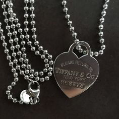 """Return to Tiffany heart tag pendant Pre-owned Gorgeous Tiffany Necklace- Return to Tiffany heart tag pendant in sterling silver, medium pendant with 36"""" chain and Tiffany bag. 100% authentic. Normal scratching on pendant. Tiffany & Co. Jewelry Necklaces"""