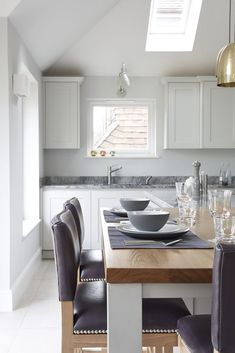 Synergy is a warm, graceful kitchen that offers an optimum balance of utility and aesthetics. The look is complemented by fascinating accent materials. House Extension Design, Extension Designs, Kitchen Extensions, House Extensions, Roof Window, Bespoke Kitchens, Interior, Table, Handmade