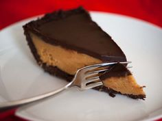This pie is every peanut butter and chocolate lover's dream. A crumbly, chocolate cookie crust cradles smooth and dense peanut butter filling, which is covered with a generous layer of dark chocolate ganache. It's an adult version of the candy classic, and big enough to treat lots of friends.