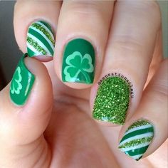 Beautiful looking four leaf clover nail art design with glitter. The various shades of green on the design make it even more creative and amazing to look at. The design makes it look that each nail is unique and stands out.