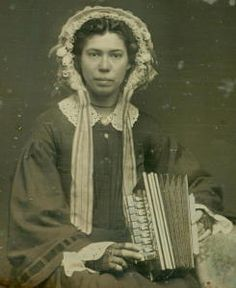 """Dag,anonymous photographer sixth plate,black lacquer case. inscribed: """"Oct. 1, 1856, Chicago"""" original price$3.00.early form of accordion known as Flutina, black fish-net gloves,great sleeves"""