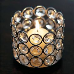 "3.25"" Dia x 2.75"" Tall Bejeweled Blitz Votive Tealight Wedding Crystal Candle Holder / Add a dash of glitz and glam to your guests tables with our bejeweled diamond crystal candle/votive holders. Radiating pure luxury, this bedazzling crystal candle holder will spectacularly highlight candles, votive, tea-lights, and even glasses and bottles. Our remarkable jewel embedded candle holder is artistically crafted with faceted round acrylic crystals and wire.  Make a stunning addition to your…"