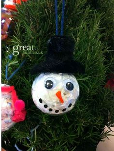 Easy Christmas ornament craft for children refillable glass baubles made into reindeer and snowman #childrenscrafts #kidscraft #christmascraft