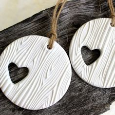 Clay ornaments ~ cut hearts out of circles then stamp with wood grain stamp. Cute!