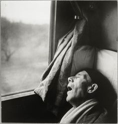 by Brassaï, Roma-Naples Express, Sleeping Man, 1955