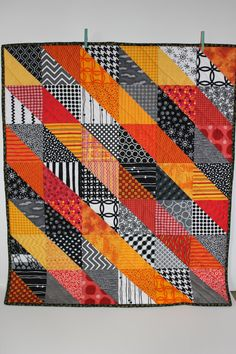 """Modern Baby Quilt """"Sean II""""; Orange; Yellow; Red; Geometric Triangles; Scrap Quilt; Lap Quilt; Play Mat; Wall Hanging; Gender Neutral"""