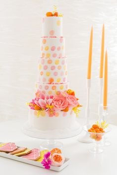 We love this bright polka-dot cake: http://www.stylemepretty.com/new-hampshire-weddings/2015/03/24/moden-citrus-inspiration-shoot/ | Photography: Kelsey DeWitt - http://kelseydewitt.com/