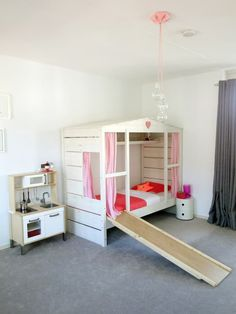 If home to you is a place of warmth and security, what better way to reinforce that feeling for children than a little home within a home? Beds designed in the shape of a house is a growing (and adorable) trend in kids spaces. From simple, minimalist versions of a house frame to enclosed, house-like structures, here are 10 examples of house beds in children's rooms.