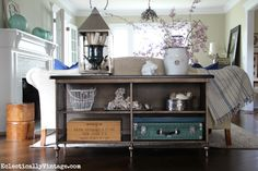 I love this sofa table - it's vintage inspired and it has tons of storage space for showing off favorite things - see how it's dressed up for spring eclecticallyvintage.com