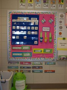 I used plastic cups hot glued to ribbon to hold our place value straws. 1st Grade Calendar, Kindergarten Calendar, Classroom Calendar, Classroom Setup, Classroom Design, Kindergarten Classroom, Classroom Organization, Preschool Calendar, Calendar Board