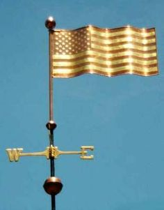American Flag Weather Vane by West Coast Weather Vanes.  This handcrafted custom made flag weathervane has optional gold leaf accents on the flag with a copper background.