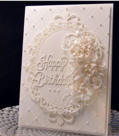 "Birthday card for Dawn, using Spellbinder dies, hand made water distressed flowers, Marianne flourish with leaves (cut apart) and Penny Black ""Happy Birthday"".(cut twice and glued together) Star Dust Stickles on flowers and half pearls for accent. 5X7 card, all layers popped with fun foam."