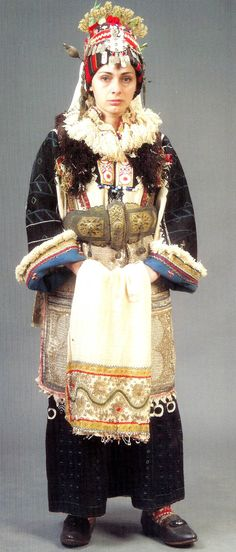 Europe | Portrait of a woman wearing a traditional bridal dress, Mirkovtsi, Skopska, Crna Gora, Macedonia