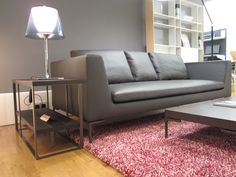 Beautiful leather Charles sofa from B&B Italia with Tekla rug in Raspberry Swirl from Kasthall adding a pop of colour