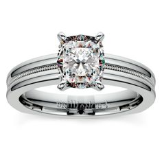 Durable beauty: Show your sweetheart that it's Forever with the elegant Rocker Milgrain Cushion Diamond Solitaire in sleek, sturdy Platinum! http://www.brilliance.com/engagement-rings/rocker-milgrain-solitaire-ring-platinum
