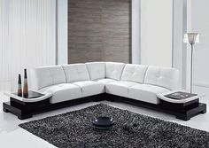 This contemporary sectional provides the ultimate seating experience. The extra padded seats and back provide comfortable support while providing plenty of room for the whole family to relax. Finished in white with attached end tables to complete the look, your living space will immediately be enhanced.