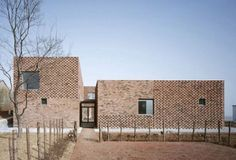 Inspired by the time-honored tradition of local brick makers, Atelier Zhanglei has designed this gorgeous modern brick home in Nanjing, China.