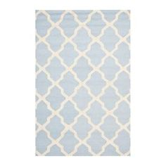 Wool rug with a trellis motif. Hand-tufted in India.  Product: RugConstruction Material: 100% WoolColor: Light blue and ivoryFeatures:  Made in IndiaHand-tufted Note: Please be aware that actual colors may vary from those shown on your screen. Accent rugs may also not show the entire pattern that the corresponding area rugs have.Cleaning and Care: Professional cleaning recommended