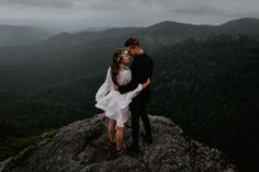 Epic mountaintop engagement photo | Image by Cody & Allison Photography
