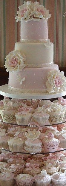 i like the cupcakes below the cake idea, but mainly white for impact!!!