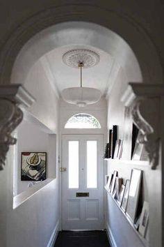 Narrow hallway entry but still plenty of personality