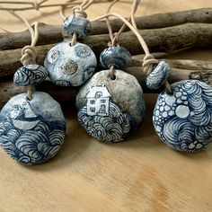 A handmade paper mache beads pendant. A real one of a kind necklace.The beads are made of recycled paper and hand shaped. ;Handpainted in beautiful doodle like, gray/blue and brown colours.This handmade paper mache pendant also handpainted and it goes with a natural colored leather cord.
