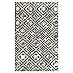 Anchor your living room seating group or define space in the den with this artfully hand-hooked cotton rug, featuring a concentric geometric motif for eye-ca...