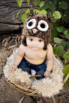 How cute would this be?  All you need is an owl hat, a round basket, and a shaggy blanket.  Definitely remembering this for the future! :)
