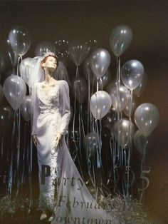 Simple and eye-catching window display with balloons. You could easily change the dress and balloons to fit other times of year and special events. Valentines Day, 4th of July or even Halloween.
