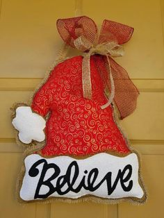A personal favorite from my Etsy shop https://www.etsy.com/listing/570490319/burlap-door-hanger-santa-hat-believe
