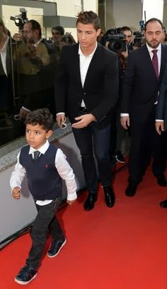 Footballer Cristiano Ronaldo's 3 year-old son, Cristiano Junior, helped his father unveil the museum plaque dedicated to him in Funchal, Madeira, Portugal, on Sunday Dec. 15th. That's a cute lil' man.The museum will display 150 of Cristiano's trophies and awards, waxworks, jerseys and everything con