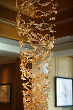 The Ritz – Carlton Hotel, Dubai - Lasvit. Whirlwind Feel the energy of Whirlwind by Tana Dvorakova with its swirling glass leaves. They exude a dynamic energy reminiscent of the romantic fall season, when sudden gusts of wind lift swirling patterns of leaves into the weightless air. A soft touch of amber recalls the warm colors of autumn. The magnificent Whirlwind sculpture features an upper stainless frame that is covered with flat and fritted glass. The 400 hand-blown glass leaves cascade…