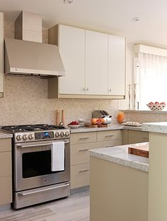 Cabinets (Applad from IKEA) Range (Frigidaire) Penny Round tiles (Saltillo tile)