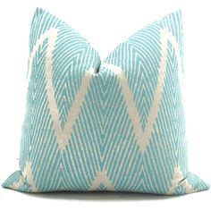 Add a Pop O Turquoise to your decor with this trendy gray and turquoise ikat chevron pillow cover. A great coordinate with other bold patterns or