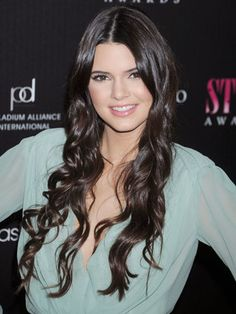To snag Kendall's style, wrap two-inch sections of hair around the barrel of a curling iron, unwind, shake out, and finish with hairspray!... love the chocolate color