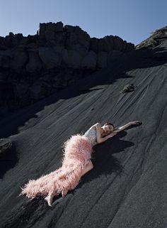 glamorous dress model posing on black sand