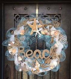 This has been sold but, i like the idea! - This large wreath is 30 diameter and is packed full of charm by using deco mesh and burlap ribbon. It is embellished with several shells of Seashell Crafts, Beach Crafts, Summer Crafts, Diy And Crafts, Seashell Wreath, Beach Christmas, Christmas Crafts, Coastal Christmas, Xmas
