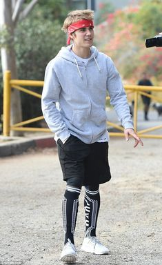 Sporty star: Justin Bieber went for a run on one of the hiking trails in Los Angeles on Tu...