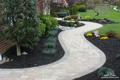 Help break up a ranch style home's linear look by adding a curved flower bed and walkway. Sidewalk Landscaping, Home Landscaping, Front Yard Landscaping, Backyard Patio, Paver Sidewalk, Concrete Walkway, Paver Walkway, Front Walkway, Walkways
